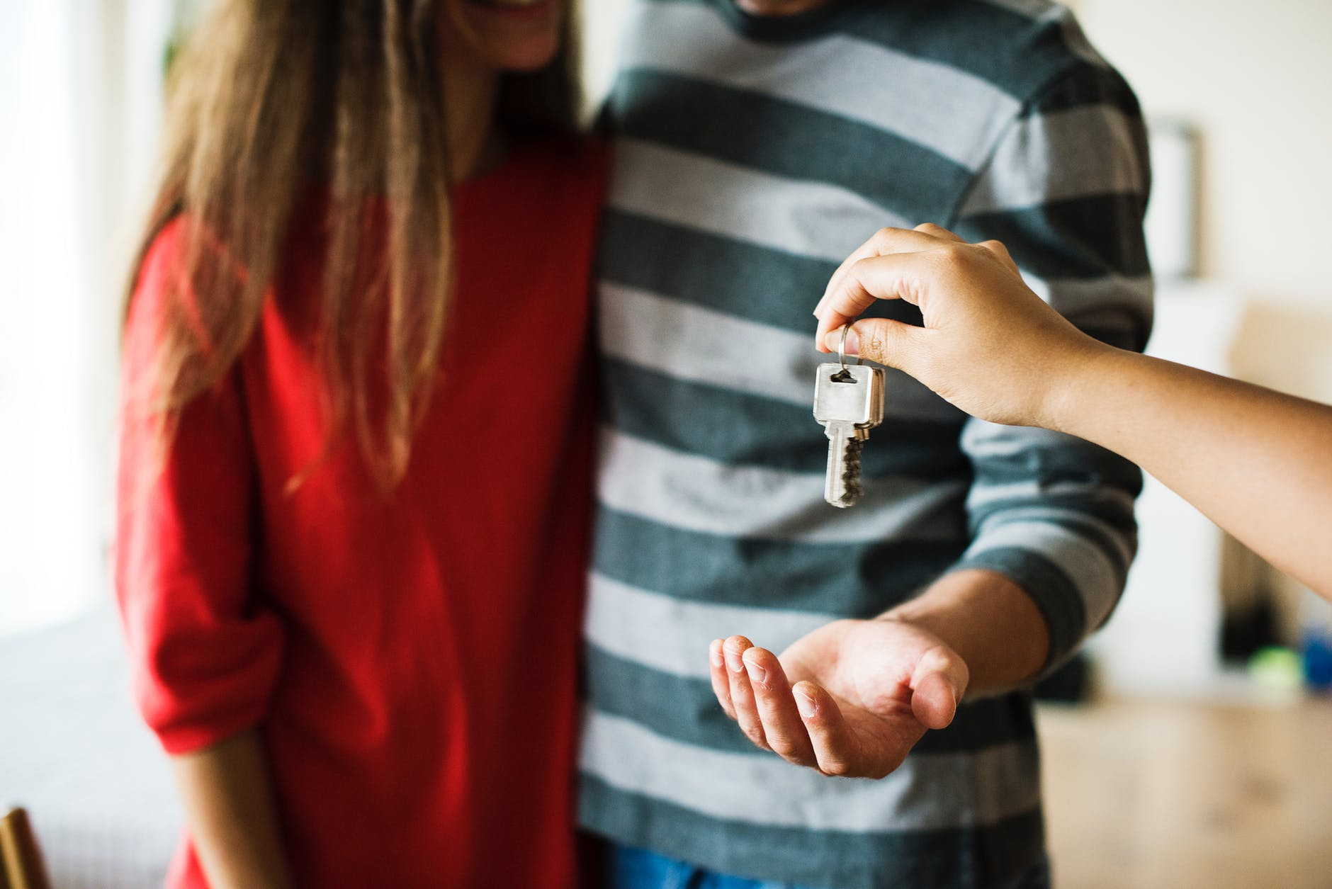 Two people getting the keys to their home.