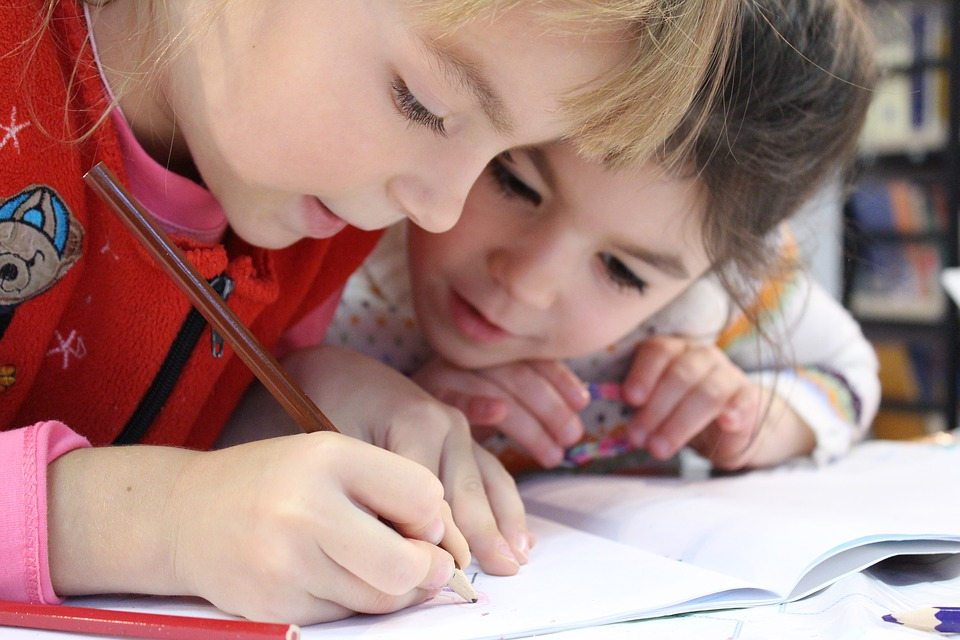 Two young children working on homework.